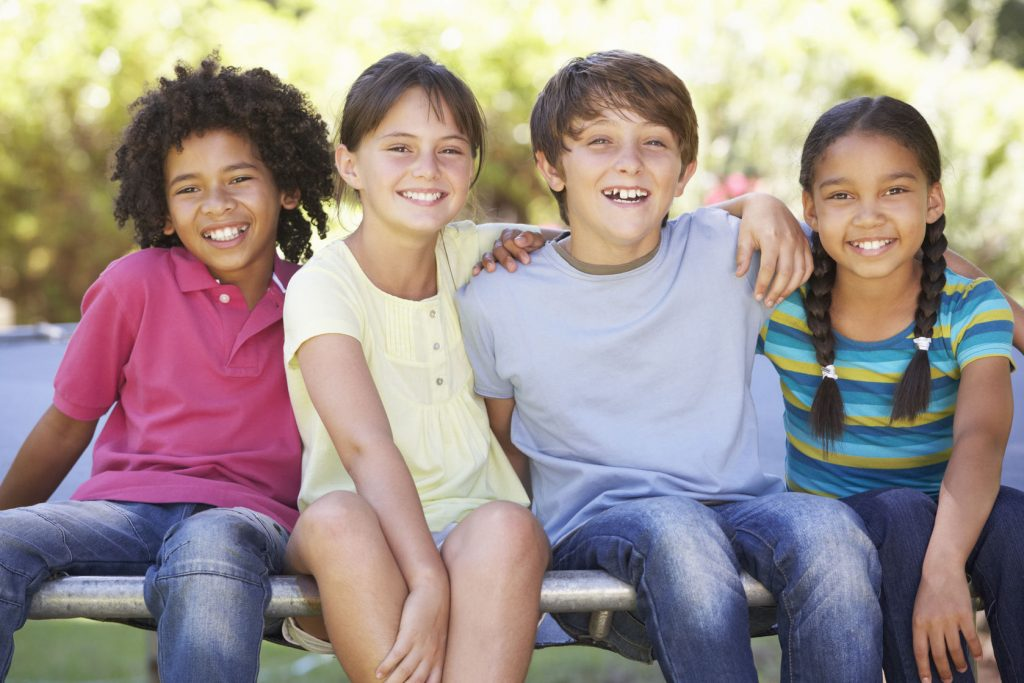 42164686 - group of children sitting on edge of trampoline together